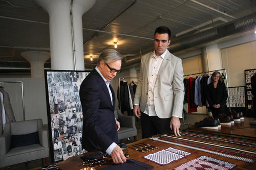 Designer Tommy Hilfiger and Baltimore Ravens Quarterback Joe Flacco get ready for Fashion Week at Hudson Studios in New York City.