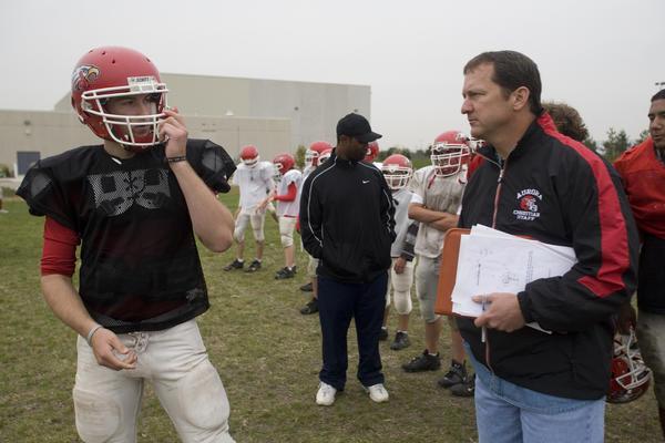 Aurora Christian quarterback Jordan Roberts talks to coach Don Beebe, right during a 2006 practice.
