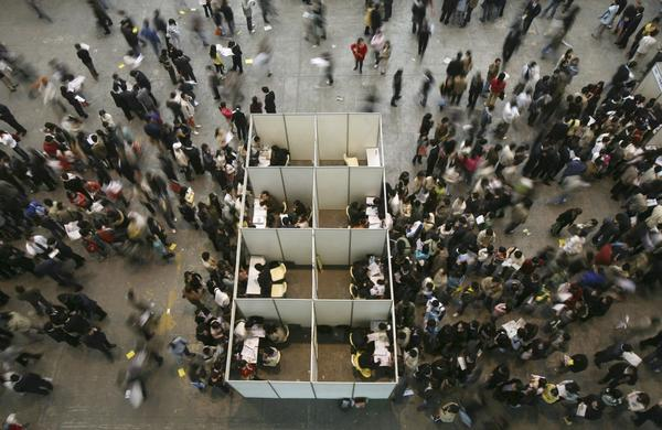 Work and job stability are sending young people's stress levels soaring. Above, a job fair.