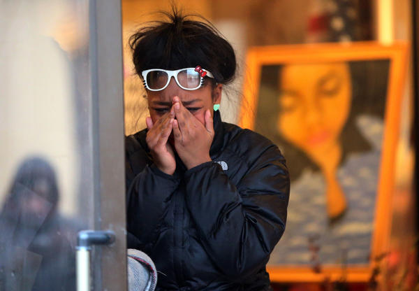 Tanique Parker, 16, cries as she leaves the wake for friend and classmate Hadiya Pendleton at Calahan Funeral Home on Chicago's South Side.