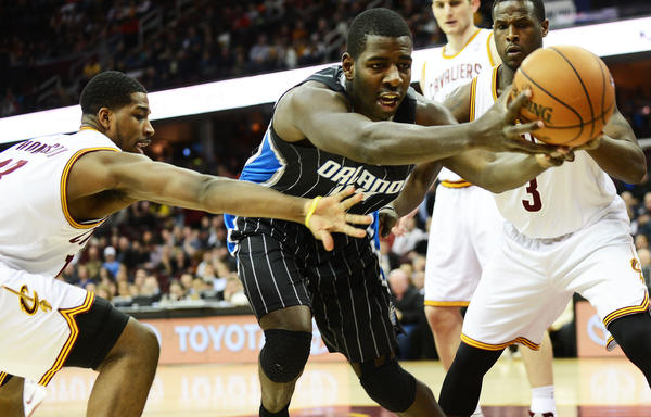 Orlando Magic power forward Andrew Nicholson (44) and Cleveland Cavaliers power forward Tristan Thompson (13) go for a loose ball during the game at Quicken Loans Arena.