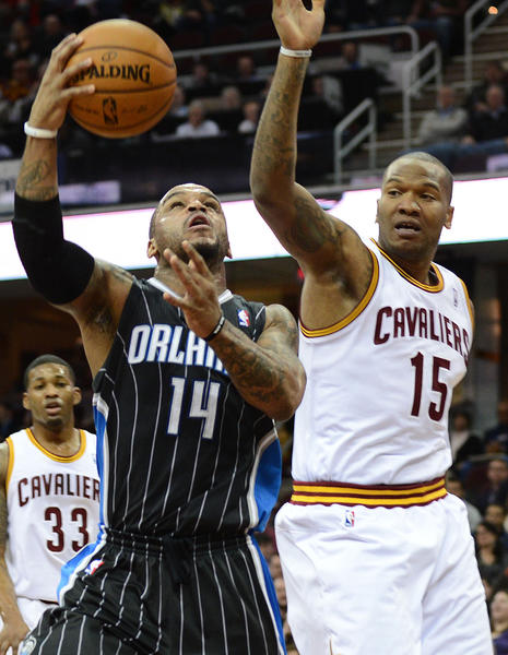 Orlando Magic point guard Jameer Nelson (14) goes up for a layup as Cleveland Cavaliers power forward Marreese Speights (15) defends during the game at Quicken Loans Arena.