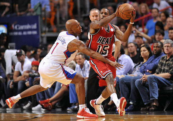 Miami Heat point guard Mario Chalmers (15) is pressured by Los Angeles Clippers point guard Chauncey Billups (1) during the first half at AAmericanAirlines Arena.