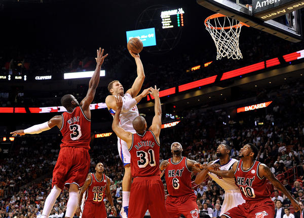 Los Angeles Clippers power forward Blake Griffin (32) drives to the basket as Miami Heat small forward Shane Battier (31) defends during the first half at AmericanAirlines Arena.