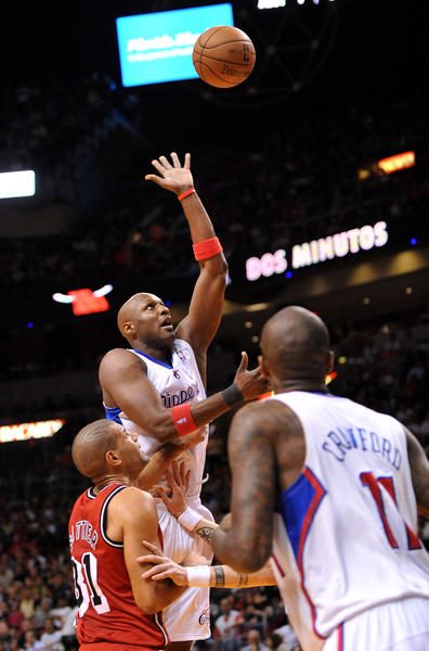 Los Angeles Clippers power forward Lamar Odom (7) drives to the basket as Miami Heat small forward Shane Battier (31) defends during the first half at AmericanAirlines Arena.