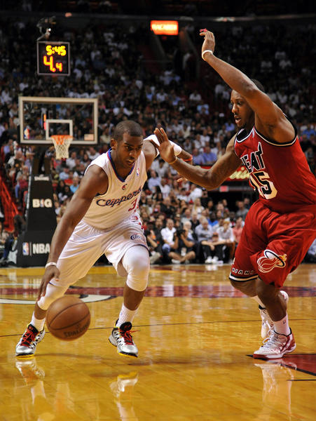 Los Angeles Clippers point guard Chris Paul (3) drives to the basket as Miami Heat small forward Shane Battier (31) defends during the first half at AmericanAirlines Arena.