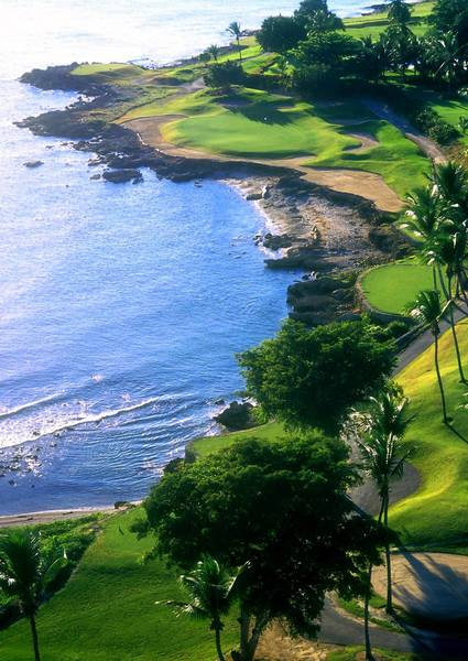 Breezes off the Caribbean on the par 3 7th hole of Casa de Campo's Teeth of the Dog course in the Dominican Republic require a well-struck shot over water. .