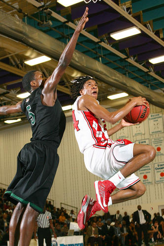 Cyonte Melvin of Hampton tries to get the shot past Rodney Bullock of Kecoughtan during the second half Friday at Woodside.