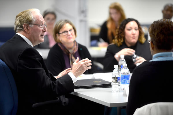 Sen. Jay Rockefeller, left, listens to local law enforcement, social services representatives, and victims during a round table discussion regarding the Violence Against Women Act Friday at the Berkeley Co. DHHR in Martinsburg.