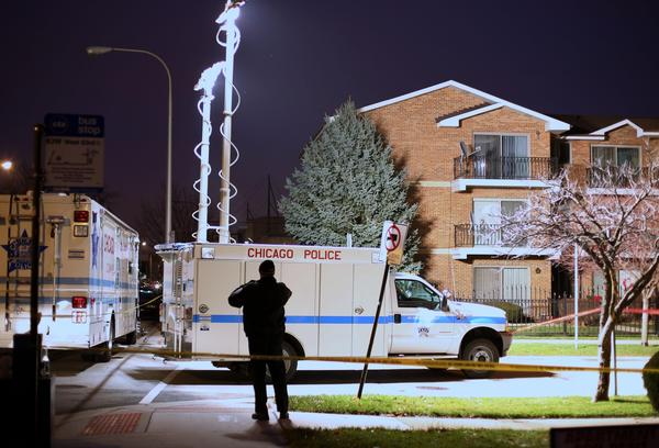 Chicago Police remain on the scene where an off-duty Chicago police officer was shot during an attempted robbery near the intersection of 63rd and Nashville in Chicago.