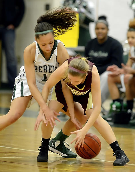 South Hagerstown's Katrice Dickson and Brunswick's Katy Miller battle for a loose ball in the first quarter of Friday night's MVAL Antietam girls basketball game.