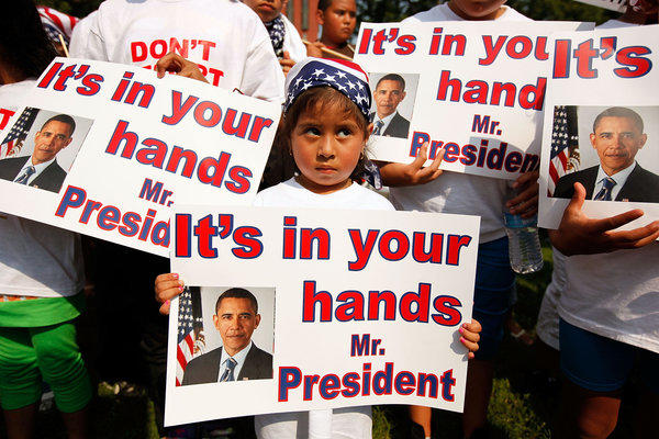 "According to the Applied Research Center's report ""Shattered Families,"" at least 5,000 children of immigrants live in U.S. foster care because their parents were detained or deported. Above: Demonstrators describing themselves as ""Obama Orphans,"" or children whose parents have been deported, are seen outside the White House in 2010."