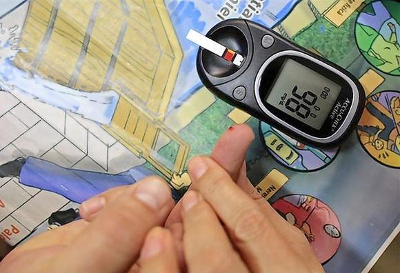 Diabetes educator Cristofor teaches how to perform a blood sugar test at the Nicolae Paulescu National Institute for Diabetes, Nutrition and Metabolic Diseases in Bucharest