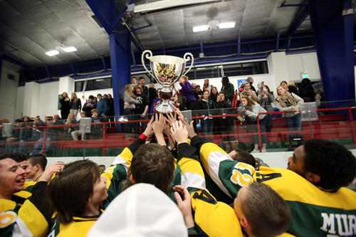 Atholton raises the Howard Cup to their fans after the win over Glenelg.