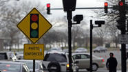 Mayor Rahm Emanuel's administration dumped the city's longtime red-light camera vendor Friday following a Tribune report about new allegations that the company gave lavish sporting trips to a former city official and then lied about it to City Hall.