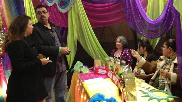 Diane and Adolfo Estrada approach the voting table for the Calexico Mardi Gras king and queen Friday night at the 15th annual Mardi Gras Beer Tasting Xperience and Business Expo. Read more about the event in Sunday¿s edition.