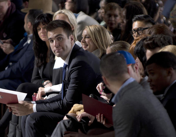 Super Bowl XLVII most valuable player Joe Flacco (C) attends the Tommy Hilfiger show at the Mercedes-Benz fashion week  in New York.