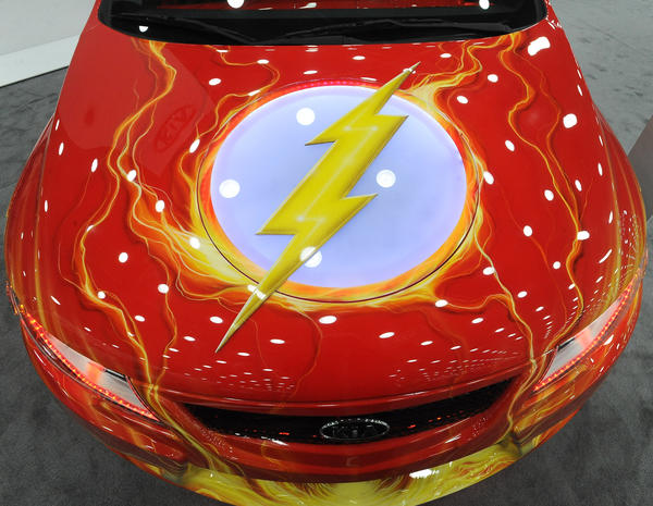 "This Kia Forte Koup was cutomized with special paint and trim, in conjunction with DC Comics, to represent the comic boook superhero ""The Flash"". This was displayed at the ""Motor Trend"" auto show which runs through Sunday at the Baltimore Convention Center."