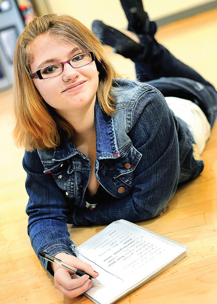 Barbara Ingram School for the Arts freshman Stephane Mohr won in the teen category for her poem titled I Love You.
