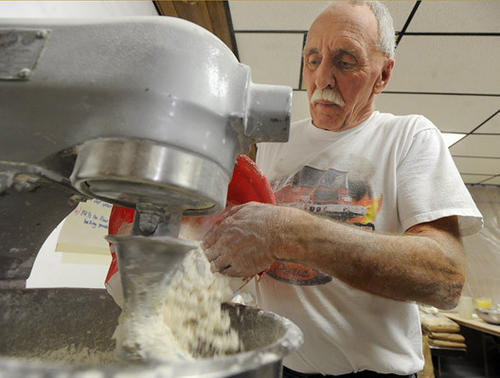 Arlan Wright of Breinigsville, a volunteer since 1966, mixes up the recipe for the fastnachts for the annual fund-raiser for the Good Will Fire Company No. 1 of Trexlertown for Fastnacht Day Saturday morning.