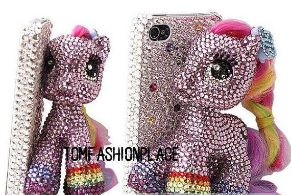 "This overly bedazzled iPhone case seems to be inspired by ""My Little Pony."" As if being covered to the teeth in crystals wasn't enough, the case comes with a horse figure attached to its back, which, of course, is also bedazzled. You can find it on Etsy for $53."