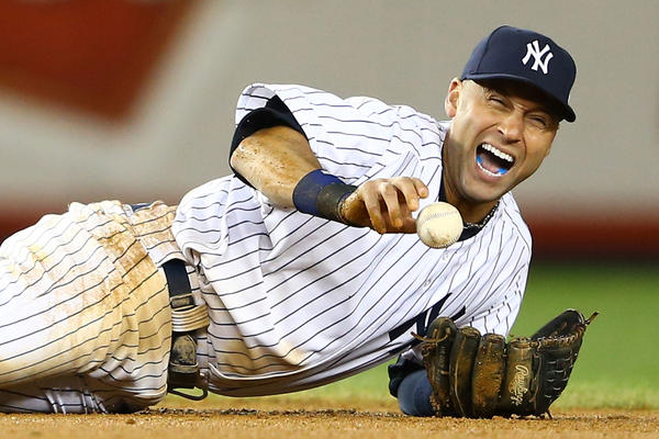 Derek Jeter reacts after he injured his leg in the top of the 12th inning against the Tigers during Game 1 of the ALCS.