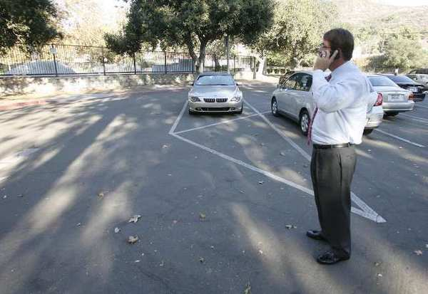 Dr. Richard Sheehan stands in a nearly empty parking lot making a call on his cell phone attempting to locate where in Verdugo Park the Glendale PTA gathered to show their support for Proposition 38. It turned out he was at the opposite end of the park.