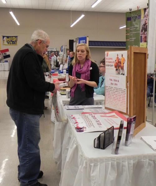 Gary Brashear, Sr., of Waynesboro talks to YMCA Membership Development Director Amanda Gietka at Saturday's Waynesboro business expo held at the Waynesboro Area Senior High School.