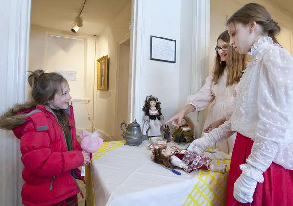 Emily Kemmerer (left), 5, of Bath talks with Annmarie Kaspern (center), 14, of Bethlehem and Rebecca Stocker (right), 12, of Nazareth, as she registers and borrows a doll from the girls during the 9th Annual Formal Tea fundraiser for the Moravian Historical Society in the Whitefield House in Nazareth. Little girls and their dolls were invited to a Victorian-era formal tea in the Bartholomew-Schisler Funeral Home, across the street from the Historical Society, where they listened to the music of the Nazareth High School String Quartet, enjoyed their tea and dined on tea sandwiches and desserts, then played victorian-era games. The Historical Society is the third oldest society in the state dating back to 1857.