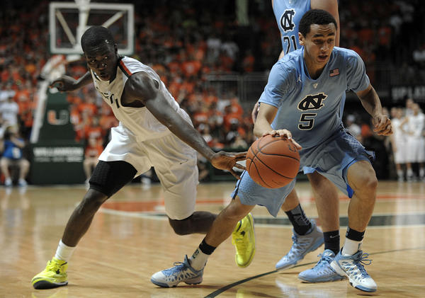 Miami guard Durand Scott reaches to steal the ball from North Carolina guard Marcus Paige during the second half of their game.