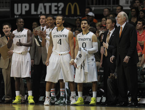 University of Miami basketball players celebrate beating North Carolina during the final seconds of their game.