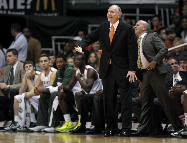 University of Miami head coach Jim Larranaga instructs his team during the first half against North Carolina.