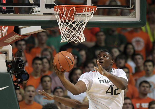 Miami center Reggie Johnson scores on a reverse layup during the second half against North Carolina.