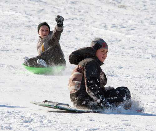 Gabriel Samsel (front), 11, and Emery Petrozelli, 12, of Nazareth, take a sleigh ride down the hill at Nazareth Borough Park on Saturday afternoon.