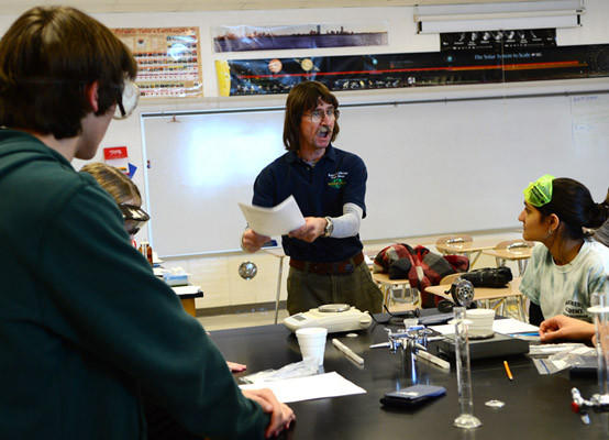 Retired Kutztown High School physics teacher Dave Drummer tells students about the ingredients they will be using in an experiment as they compete against each other in a science lab competition. All students are given the supplies to create their own experiments and they must analyze the work they do. The 6th Tiger Invitational Science Olympiad at Northwestern Lehigh High School featured students from 16 schools Saturday. Students from some schools could not attend because of the weather.
