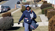 Wanda Feagen pulled on her blue United States Postal Service coat and a pair of thick black gloves shortly after 10 a.m. Saturday, blinking against a hard wind and waiting for her mail delivery truck to fill up on gas.