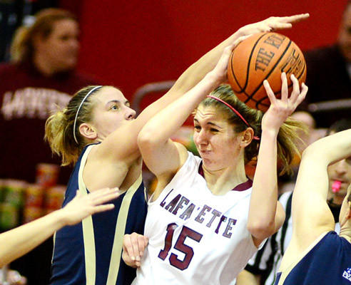 Lafayette's Emily Homan, 15, pulls a rebound away from Navy's Jade Geif Saturday. Navy beat Lafayette in women's basketball 60 - 52 in overtime.