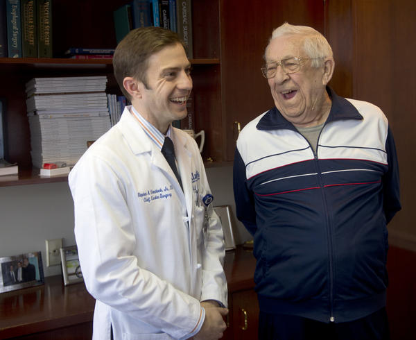 Dr. Stephen Olenchock Jr., Chief Cardiac Surgery, Cardiovascular and Thoracic Surgical Associates of St. Luke's, and his patient Bill Trauger, of Hatfield, pose in his office. Cardiac patients who need aortic valve replacement but are too frail to survive open heart surgery can benefit from a new transcatheter procedure which allows the heart valve to be replaced without invasive surgery.