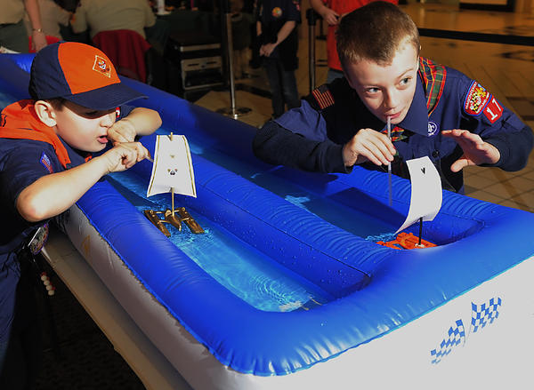 Jacob Benfield, left, and Trinity Souders puff hard to propel sailboats. The Mason-Dixon Council of the Boy Scouts of America hosted Derby Dayz at Valley Mall, where Scouts, families and friends had the opportunity to race cars, boats and rockets in the Pinewood Derby, Raingutter Regatta and Space Derby.