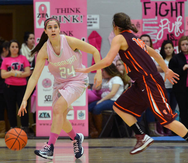 Moravian's Alyssa Hann (24) dribbles down court against Susquehanna's Ainsley Rossitto (10) during a women's basketball game on Saturday. Hann is from Nazareth. It was Pink Zone Day for women to help raise funds to donate to the Kay Yow Cancer Fund.