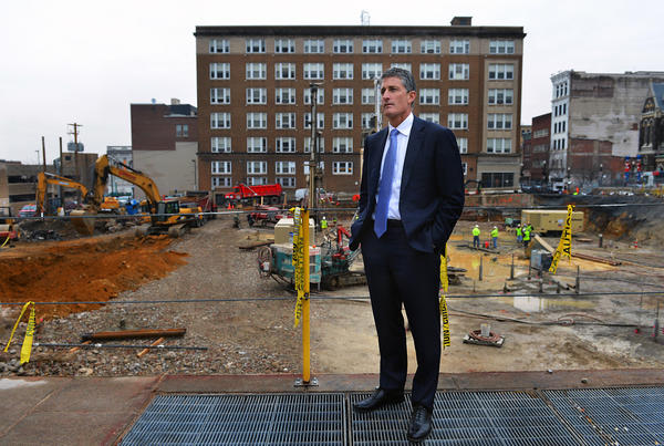 City Center Investment C.E.O J.B. Reilly stands near Two City Center, an upscale apartment and retail complex, the four-story building will be at the southeast corner of Seventh and Linden. City Center Investment Corp. is developing a major mixed-use project around Allentown's Seventh and Hamilton streets.