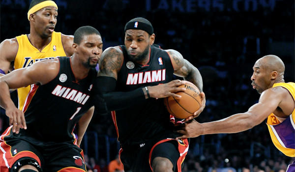 LeBron James, center, is averaging 26.9 points, 8.1 rebounds and 6.9 assists a game for the Heat this season.