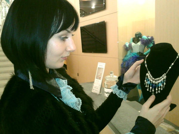 """Robinwood Players Theater Club President Natalie Nebesnyuk, 25, of Lviv, Ukraine, made a necklace of pearls, bohemian glass, and Swarovski crystals that attendees of """"An Evening of Music and Poetry"""" at the Kepler Center at Hagerstown Community College could win in a lottery by making a donation."""