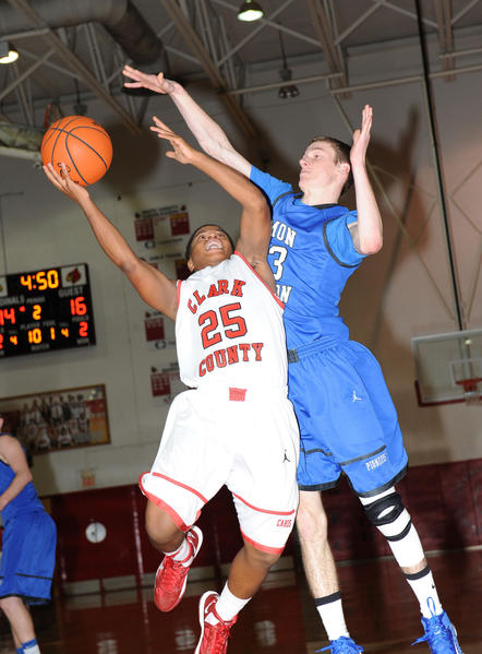 George Rogers Clark High¿School guard Josiah Israel drives to the basket as Simon Kenton¿s Noah Robinson defends in the first half of a 50-42 loss to the Pioneers Friday night at Norton Gymnasium.
