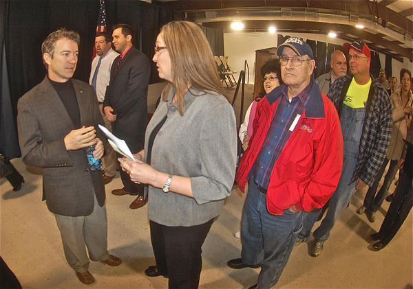 Sen. Rand Paul, left, talks with Liberty dentist Michelle Beeler while other wait in line for their turn Friday at the Ag/Expo Center in Casey County.