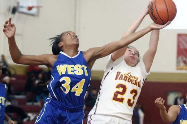 West Los Angeles' Shandrea Fortune, left, attempts to steal the ball from GCC's Bianca Galicia.