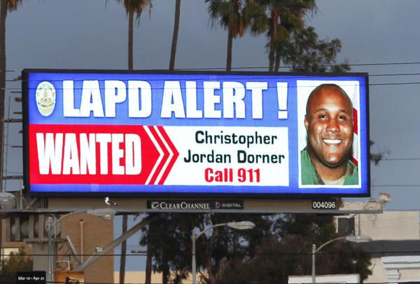 """A digital billboard along Santa Monica Boulevard shows a """"wanted"""" alert for former Los Angeles police officer Christopher Dorner."""