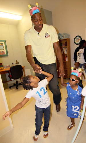 The Lakers' Dwight Howard visits with teen mothers and their children at the BETA Center in Orlando, which houses and serves at-risk teen mothers and their children.
