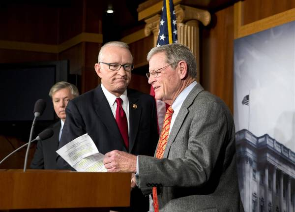 "House Armed Services Committee Chairman Howard P. ""Buck"" McKeon (R-Santa Clarita), center, and Senate Armed Services Committee Ranking Member Jim Inhofe (R-Okla.), right, at a news conference about the looming automatic spending cuts."