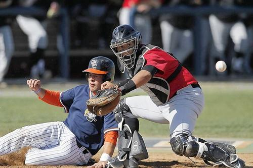 Orange Coast College's Christian Fillingame, left, beats the tag at home against Long Beach City College's Bobby Dutter in the second inning during the Pirates' home opener on Saturday.